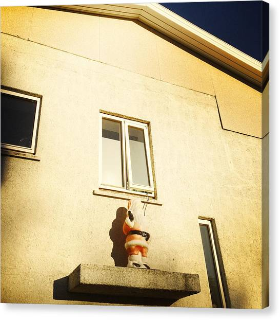 House Canvas Print - Xmas Decoration With Santa In June Akureyri Iceland by Matthias Hauser