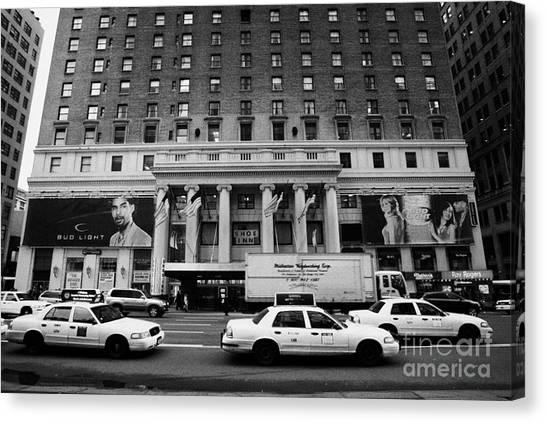 Manhatan Canvas Print - Yellow Cabs Go Past Pennsylvania Hotel On 7th Avenue New York City Usa by Joe Fox