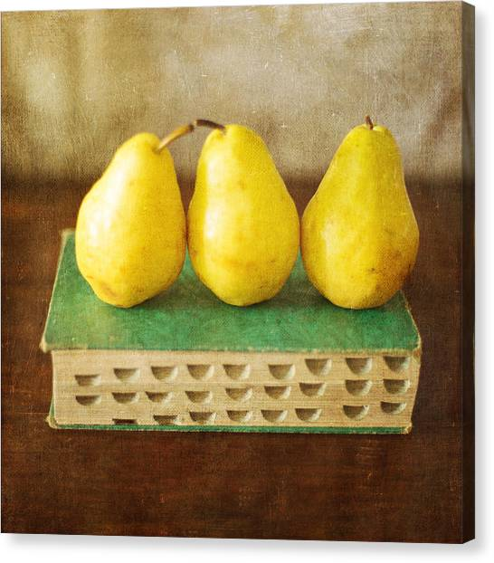 Yellow Pears And Vintage Green Book Still Life Canvas Print