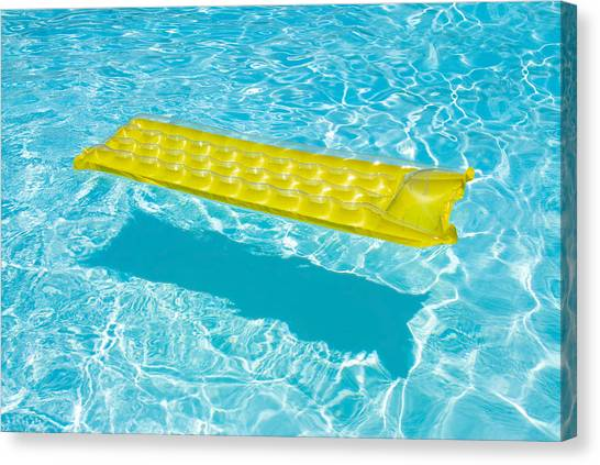 Yellow Raft Floating In A Pool Canvas Print