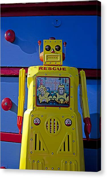 Drawers Canvas Print - Yellow Robot In Front Of Drawers by Garry Gay