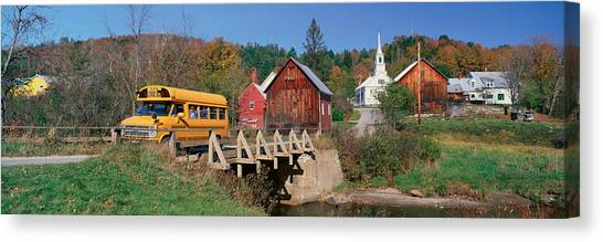 School Buses Canvas Print - Yellow School Bus Crossing Wooden by Panoramic Images
