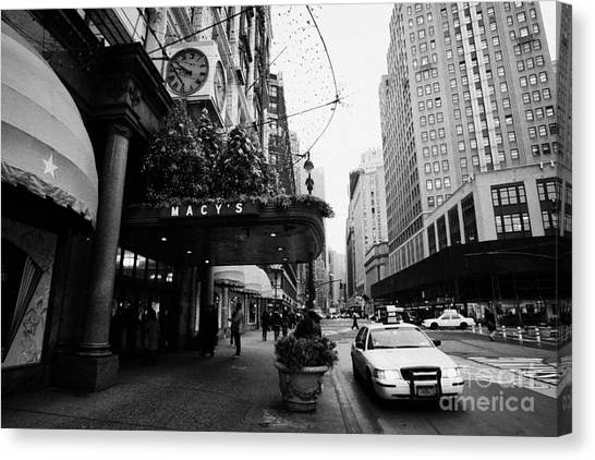 Manhatan Canvas Print - yellow taxi cab waits outside entrance to Macys department store on Broadway and 34th street by Joe Fox