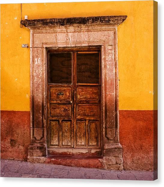 San Miguel De Allende Canvas Print - Yellow Wall Wooden Door by Carol Leigh