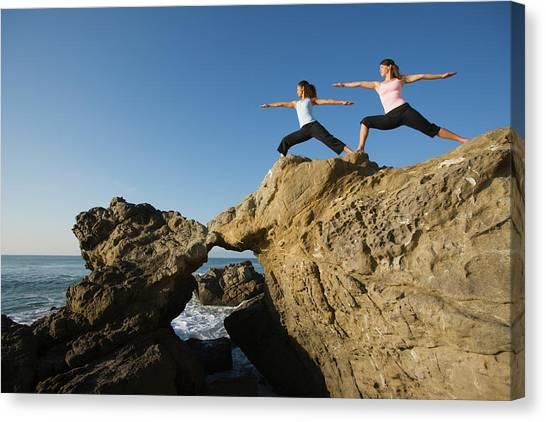 Yogi Canvas Print - Yoga On Rocky Coast by Ty Milford