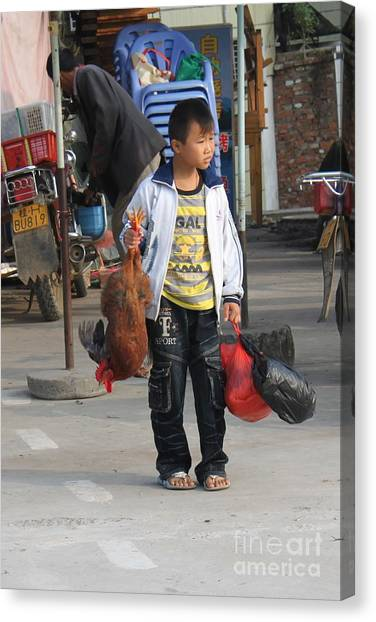 Young Boy Carrying A Dead Chicken To School Canvas Print