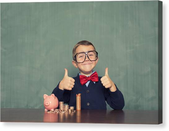 Young Boy Nerd Saves Money In His Piggy Bank Canvas Print by RichVintage