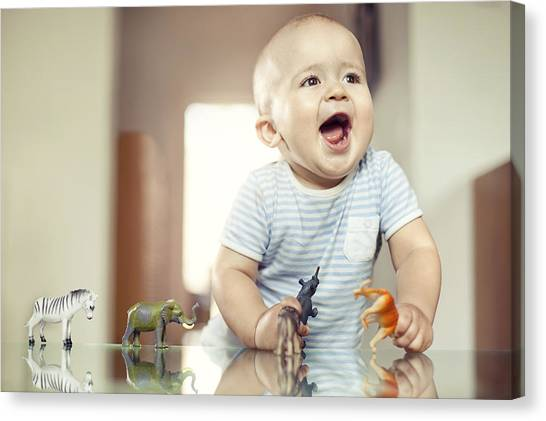 Young Boy Playing With Toy Animals Canvas Print by Orbon Alija