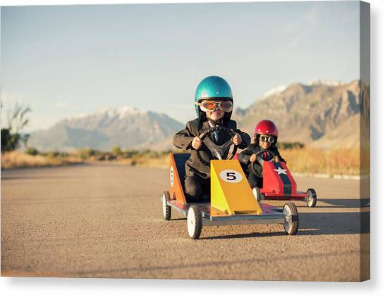 Young Boy Races Toy Car Wearing Canvas Print by Richvintage