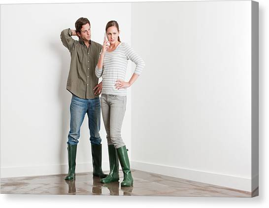 Young Couple On Flooded Floor Canvas Print by Image Source