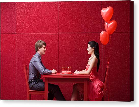 Young Couple With Cake Canvas Print by Image Source