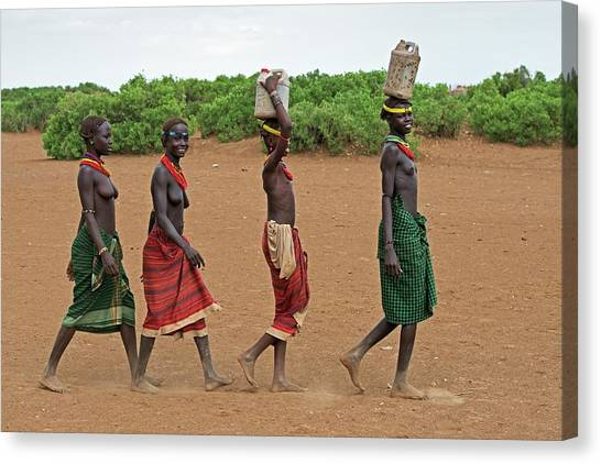 Ethiopian Woman Canvas Print - Young Dassenech Girls Carrying Water by Tony Camacho