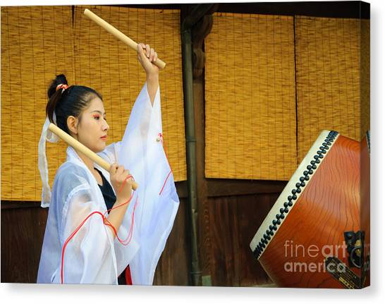 Young Japanese Lady In Period Costume Playing Taiko Drum Canvas Print