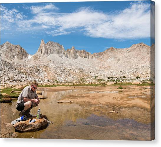 df183f8f8b Sunglasses Reflection Canvas Print - Young Man Filtering Water by Josh  Miller Photography