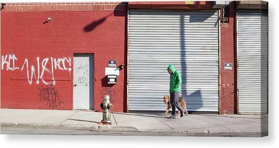 Young Man Walks Dog Canvas Print