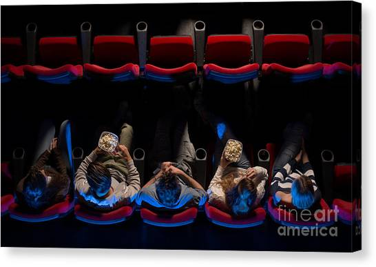 Young People Sitting At The Cinema Canvas Print by Stock-asso