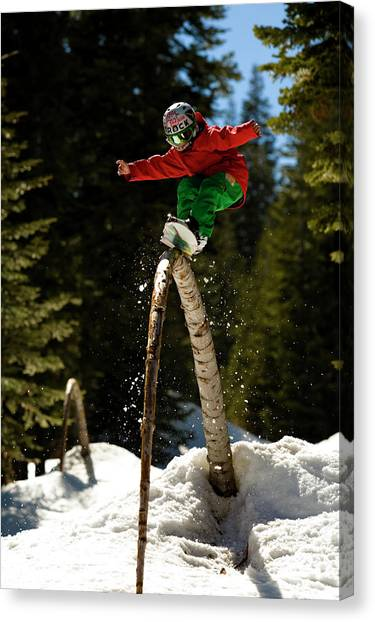 Jibbing Canvas Print - Young Snowboard Kid Shreds A Natural by Jeff Curtes