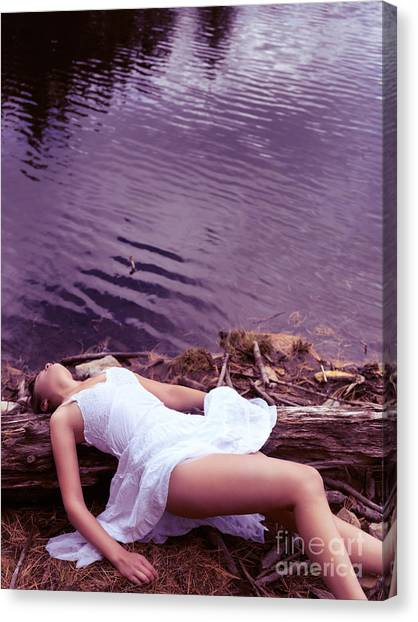 Unconscious Canvas Print - Young Woman In White Dress Lying Near Lake by Oleksiy Maksymenko