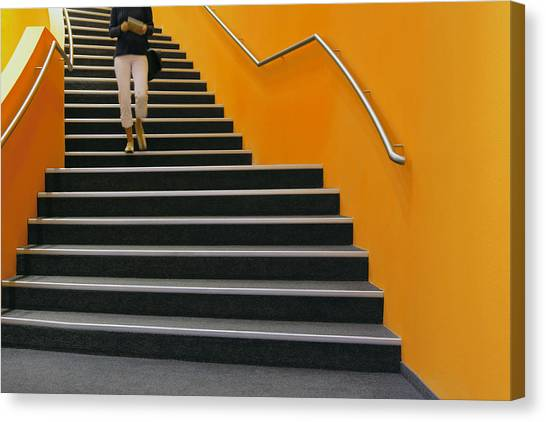 Young Woman Walking Down Orange Stairs, Reading Book Canvas Print by B&M Noskowski