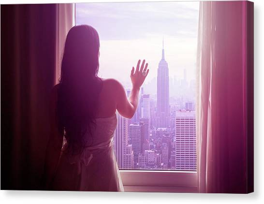 Young Woman With Hand On Window And New Canvas Print by Flavia Morlachetti