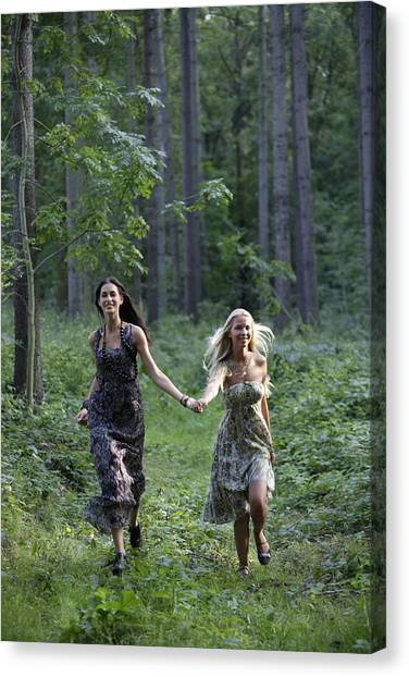 Young Women Running Through Forest Canvas Print by Asia Images