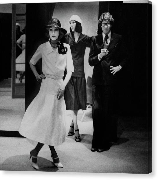Yves Saint Lauren With Two Of His Assistants Canvas Print by Deborah Turbeville