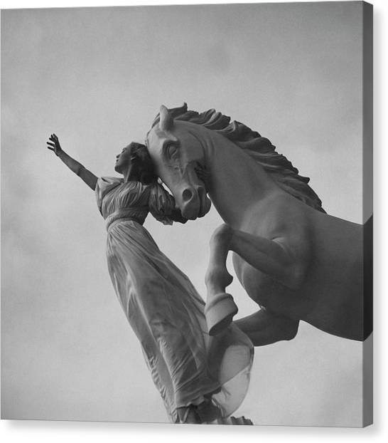 Zorina With A Horse Statue Canvas Print by Toni Frissell