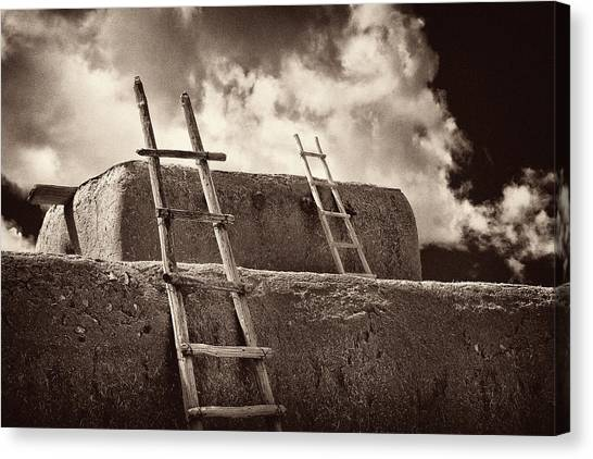 Adobe Ladders Canvas Print by Christine Hauber
