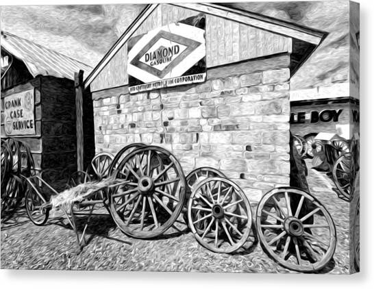 Antique Wagon Wheels Canvas Print by James Steele