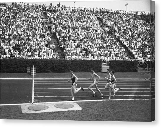 Track Athletes Running On Track, (b&w), Elevated View Canvas Print by George Marks