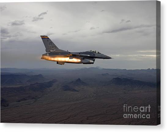 National Guard Canvas Print - An F-16 Fighting Falcon Fires An Agm-65 by HIGH-G Productions