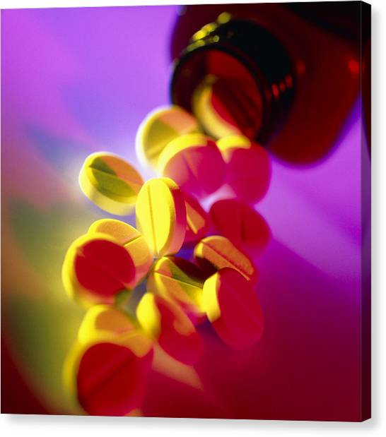 Aspirin Pills Spilled From A Bottle Canvas Print by Tek Image