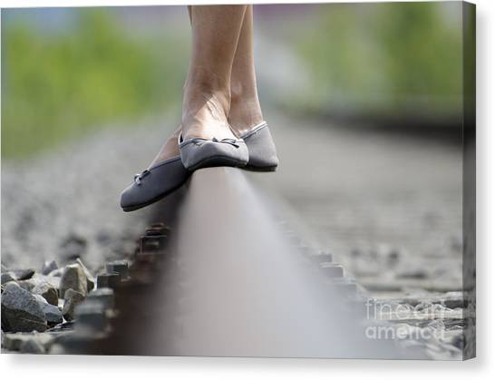 Balance On Railroad Tracks Canvas Print