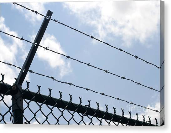 Chain Link Fence Canvas Print - Barbed Wire by Blink Images