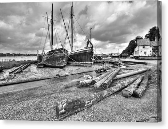 Boats And Logs At Pin Mill  Canvas Print