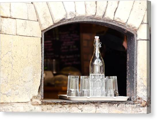 Bottle Of Water And Glasses Canvas Print