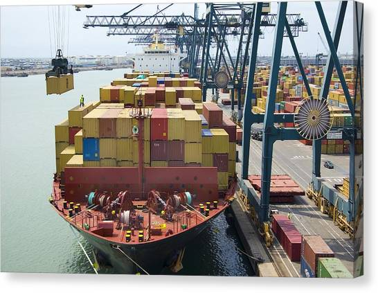 Container Ship And Port Canvas Print by Dr Juerg Alean