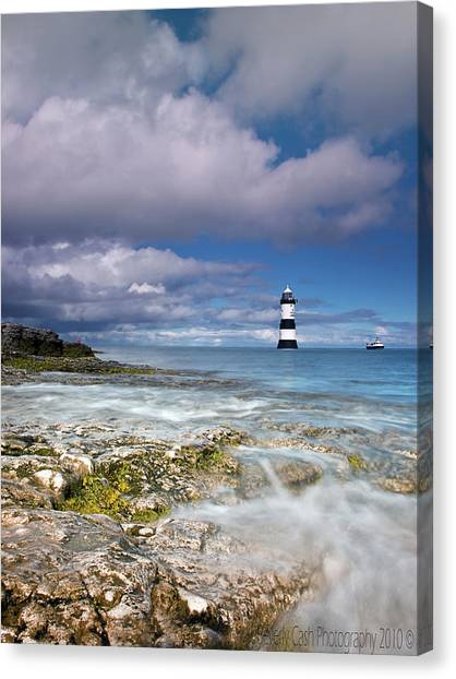 Fishing By The Lighthouse Canvas Print