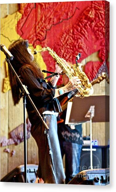 Harjo On Sax Canvas Print by James Knights