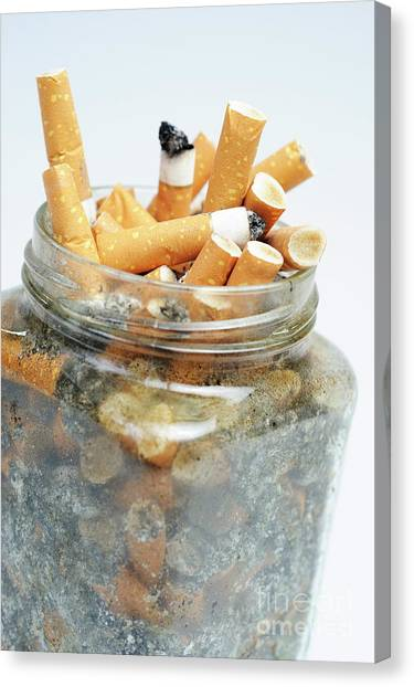 Jar Overflowing With Cigarette Butts Canvas Print by Sami Sarkis
