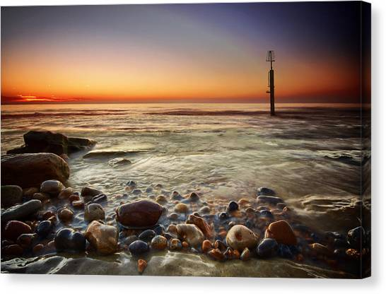 Pebbles Canvas Print by Mark Leader