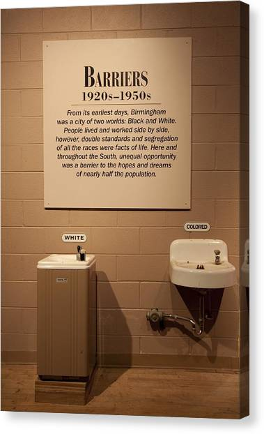 Segregated Water Fountains On Display Canvas Print by Everett