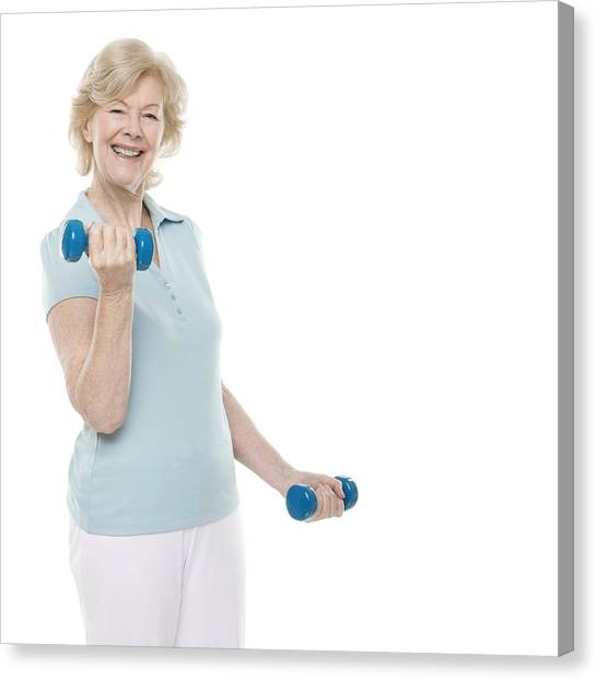Senior Woman Lifting Weights Canvas Print by