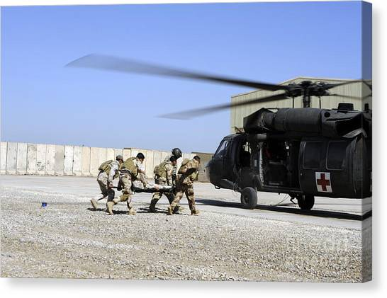 Medivac Canvas Print - Soldiers Rush A Simulated Casualty by Stocktrek Images