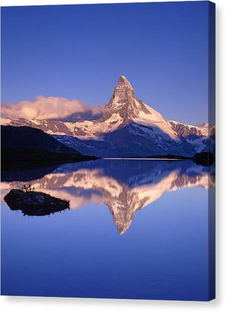 The Matterhorn Reflecting In Lake Canvas Print by Brian Lawrence