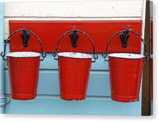Three Red Buckets Canvas Print