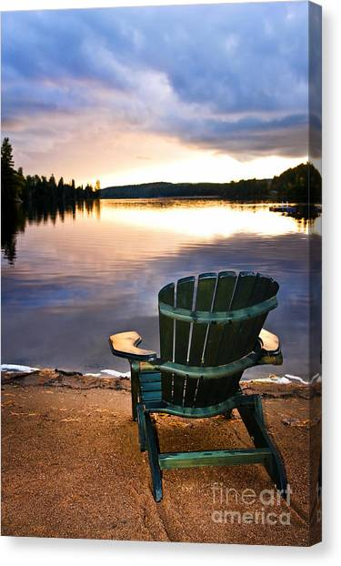 Algonquin Park Canvas Print - Wooden Chair At Sunset On Beach by Elena Elisseeva