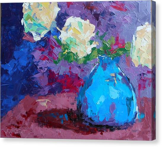 Yellow Roses In A Blue Vase Canvas Print