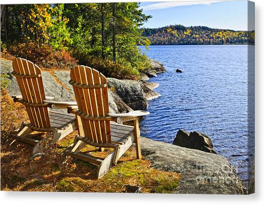 Chairs Canvas Print - Adirondack Chairs At Lake Shore by Elena Elisseeva