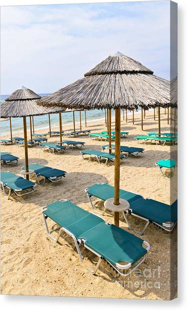 Sandy Desert Canvas Print - Beach Umbrellas On Sandy Seashore by Elena Elisseeva